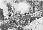 Wide angle view of RGS #20 with K-27 #455 double-heading a freigth across bridge 22-A northbound.<br /> RGS  n. of Brown, CO  Taken by Moedinger, William - 8/1941