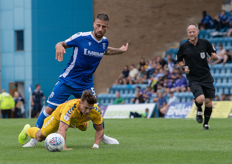 Bolton Wanderers' Dennis Politic (left) brought down by Gillingham's Max Ehmer's (right) tackle <br /> <br /> Photographer David Horton/CameraSport<br /> <br /> The EFL Sky Bet League One - Gillingham v Bolton Wanderers - Saturday 31st August 2019 - Priestfield Stadium - Gillingham<br /> <br /> World Copyright © 2019 CameraSport. All rights reserved. 43 Linden Ave. Countesthorpe. Leicester. England. LE8 5PG - Tel: +44 (0) 116 277 4147 - admin@camerasport.com - www.camerasport.com