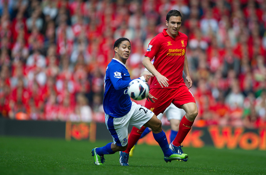 Everton's Steven Pienaar and Liverpool's Stewart Downing .. - (Photo by Stephen White/CameraSport) - ..Football - Barclays Premiership - Liverpool v Everton - Sunday 5th May 2013 - Anfield - Liverpool..© CameraSport - 43 Linden Ave. Countesthorpe. Leicester. England. LE8 5PG - Tel: +44 (0) 116 277 4147 - admin@camerasport.com - www.camerasport.com