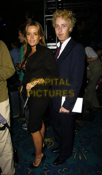 DAVINIA TAYLOR & GUEST.At the Julien Macdonald Spring Summer 2007 Catwalk Show during London Fashion Week,.Hilton Park Lane Hotel, London,.England, September 22nd 2006..full length murphy taylor-murphy black dress.Ref: CAN.www.capitalpictures.com.sales@capitalpictures.com.©Can Nguyen/Capital Pictures