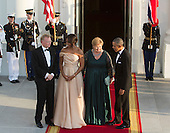 United States President Barack Obama and First Lady Michelle Obama welcome Erna Solberg, Prime Minister of Norway (2nd right) and spouse Sindre Finnes (left) as they arrive May 13, 2016 at The White House in Washington, DC to attend a State Dinner while participating in the U.S.- Nordic Leaders Summit.<br /> Credit: Chris Kleponis / CNP