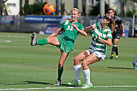 8 November 2015:  Marshall Forward Erin Simmons (32) attempts to kick to the goal despite the efforts of North Texas Defender Tess Graham (7) in first half as the University of North Texas Mean Green defeated the Marshall University Thundering Herd, 1-0, in the Conference USA championship game at University Park Stadium in Miami, Florida.