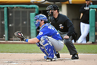 Taylor Teagarden (23) of the Las Vegas 51s behind the plate with home plate umpire Jordan Ferrell in action with the Salt Lake Bees at Smith's Ballpark on May 8, 2014 in Salt Lake City, Utah.  (Stephen Smith/Four Seam Images)