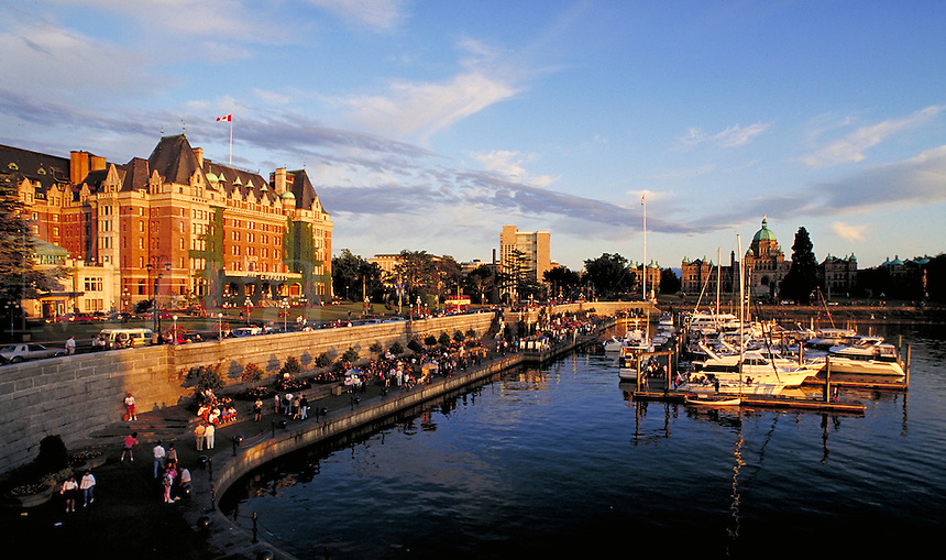 City center featuring harbourfront promenade and the landmark Empress Hotel, one of Canadian Pacific's grand hotels. British Columbia provincial parliament buildings in the background. luxury, accommodation, tourism, tourist attraction, sunset, yac cht. Canada