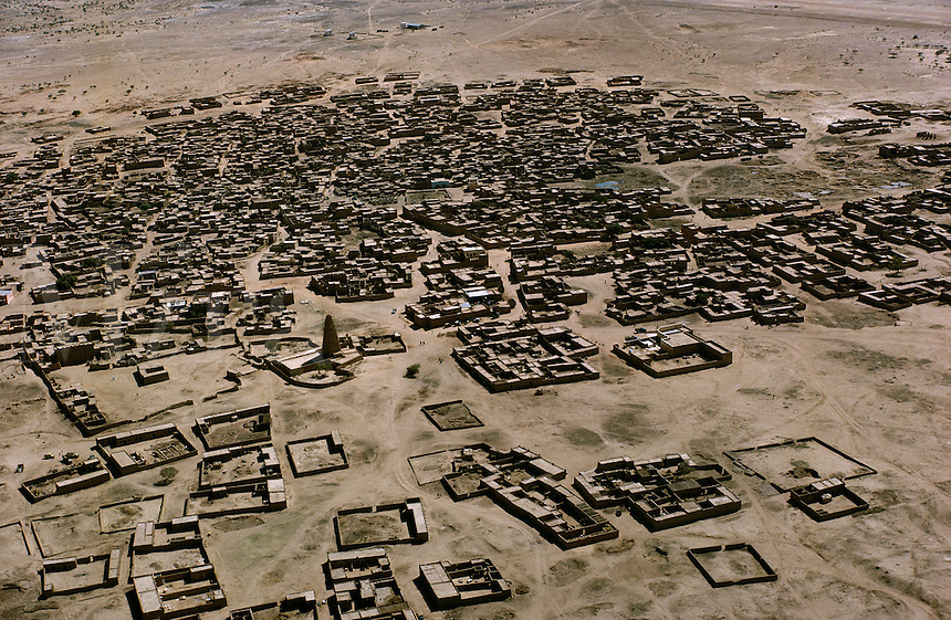 Aerial view of Agadez, Niger, Africa. Tower at center left is mosque; town is made of mud houses..