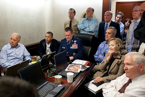 United States President Barack Obama and Vice President Joe Biden, along with with members of the national security team, receive an update on the mission against Osama bin Laden in the Situation Room of the White House, Sunday, May 1, 2011. Please note: a classified document seen in this photograph has been obscured. .Mandatory Credit: Pete Souza - The White House via CNP