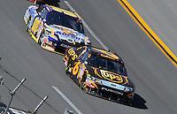 Apr 26, 2009; Talladega, AL, USA; NASCAR Sprint Cup Series driver David Ragan (6) leads David Reutimann (00) during the Aarons 499 at Talladega Superspeedway. Mandatory Credit: Mark J. Rebilas-