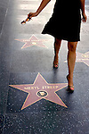 Woman walking along Hollywood Boulevard's Walk of Fame