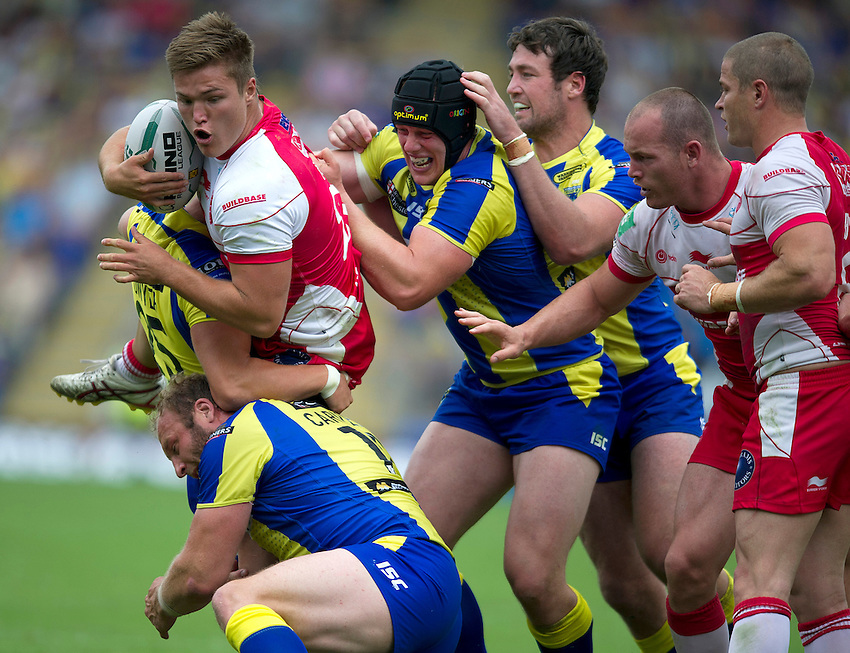 Hull Kingston Rovers' Tyler Hepi is tackled by Warrington Wolves' Garreth Carvell, Chris Hill, Brad Dwyer  and Trent Waterhouse <br /> <br />  (Photo by Stephen White/CameraSport) <br /> <br /> Rugby League - Super League - Warrington Wolves v Hull Kingston Rovers - Sunday 21st July 2013 - Halliwell Jones Stadium - Warrington<br /> <br /> &copy; CameraSport - 43 Linden Ave. Countesthorpe. Leicester. England. LE8 5PG - Tel: +44 (0) 116 277 4147 - admin@camerasport.com - www.camerasport.com