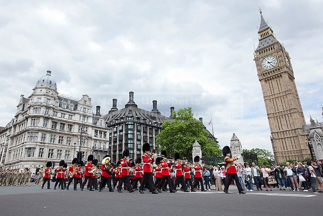 19/06/2012. LONDON, UK. Members of the British Army's 20 Armoured Brigade are led by guards bandsmen as they parade through Westminster as they march to the Houses of Parliament for a reception with MPs following their return from Afghanistan. Photo credit: Matt Cetti-Roberts
