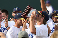 Members of the UNC Greensboro Spartans kiss the trophy after the team won the Southern Conference Championship on Sunday, May 28, 2017, at Fluor Field at the West End in Greenville, South Carolina, by beating the Furman Paladins 13-1. (Tom Priddy/Four Seam Images)
