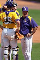 LSU Tigers coach Paul Mainieri  meets on the pitchers mound during the NCAA baseball game against the Mississippi State Bulldogs on March 18, 2012 at Alex Box Stadium in Baton Rouge, Louisiana. LSU defeated Mississippi State 4-2. (Andrew Woolley / Four Seam Images).