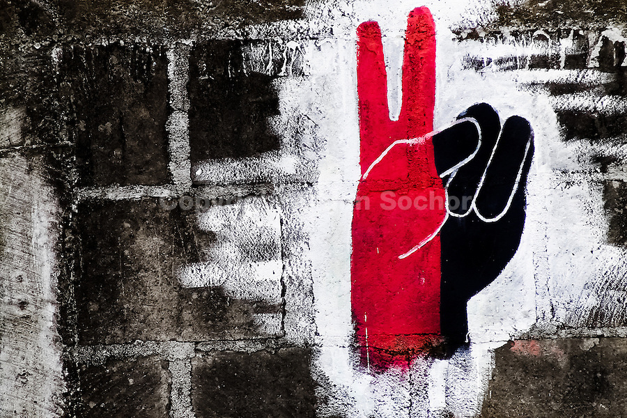 The victory symbol, in the black-and-red colours of Sandinistas, painted on the wall in San Juan del Sur, Nicaragua, 16 October 2004. The Sandinista National Liberation Front (in Spanish: Frente Sandinista de Liberación Nacional, or FSLN) is a socialist political party in Nicaragua. The FSLN is one of Nicaragua's two leading parties. Sandinistas took their name from Augusto César Sandino (1895-1934), the historical leader of Nicaragua's nationalist rebellion against the US occupation of the country in the 1930s. In 1979 the FSLN overthrew the Somoza dynasty and ruled Nicaragua from 1979 to 1990. They left power in 1990 after free elections. In 2006, the former President Daniel Ortega, the leader of the party, was re-elected President of Nicaragua.