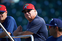 Fort Myers Miracle hitting coach Jim Dwyer (center) talks with pitching coach Henry Bonilla (right) and trainer Alan Rail (left) during practice before a game against the Bradenton Marauders on April 9, 2016 at McKechnie Field in Bradenton, Florida.  Fort Myers defeated Bradenton 5-1.  (Mike Janes/Four Seam Images)