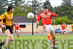 Tom McGoldrick of Brosna clears the ball past Eamon McElligott of Asdee last Sunday in Brosna