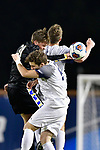 GREENSBORO, NC - DECEMBER 02: Henrik Roesholt #31 of North Park University battles Colby Thomas #5 of Messiah College during the Division III Men's Soccer Championship held at UNC Greensboro Soccer Stadium on December 2, 2017 in Greensboro, North Carolina. Messiah College defeated North Park University 2-1 to win the national title. (Photo by Grant Halverson/NCAA Photos via Getty Images)