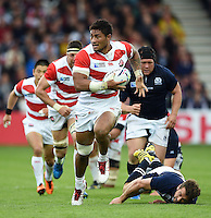 Amanaki Mafi of Japan takes on the Scotland defence. Rugby World Cup Pool B match between Scotland and Japan on September 23, 2015 at Kingsholm Stadium in Gloucester, England. Photo by: Patrick Khachfe / Onside Images
