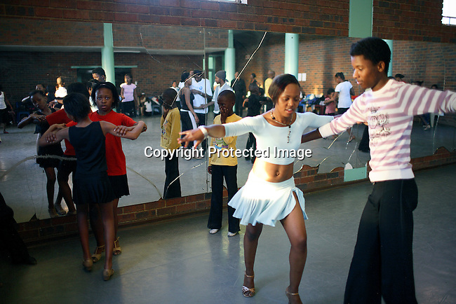 Members of a ball room dancing club rehearse in Pimville community Hall.