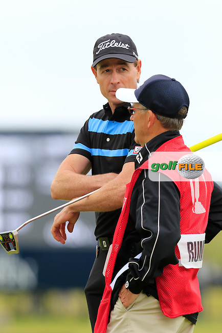 Brett Rumford (AUS) and caddy John &quot;Ronnie&quot; Roberts on the 17th green during Monday's Final Round of the 144th Open Championship, St Andrews Old Course, St Andrews, Fife, Scotland. 20/07/2015.<br /> Picture Eoin Clarke, www.golffile.ie