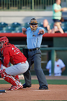 Home plate umpire Sam Burch calls a batter out on strikes behind catcher Jose Godoy (27) during a game between the Palm Beach Cardinals and the Florida Fire Frogs on May 1, 2018 at Osceola County Stadium in Kissimmee, Florida.  Florida defeated Palm Beach 3-2.  (Mike Janes/Four Seam Images)