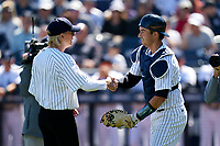 New York Yankees catcher Kyle Higashioka (66) shakes hands with Tampa Mayor Jane Castor after throwing out the ceremonial first pitch before a Spring Training game against the Toronto Blue Jays on February 22, 2020 at the George M. Steinbrenner Field in Tampa, Florida.  (Mike Janes/Four Seam Images)