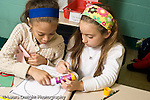 Education Elementary school Grade 2 mathematics two girls working on project together.horizontal