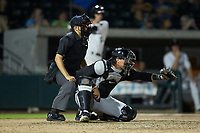 Kannapolis Intimidators catcher Michael Hickman (16) frames a pitch as home plate umpire Josh Gilreath looks on during the game against the Augusta GreenJackets at SRG Park on July 6, 2019 in North Augusta, South Carolina. The Intimidators defeated the GreenJackets 9-5. (Brian Westerholt/Four Seam Images)