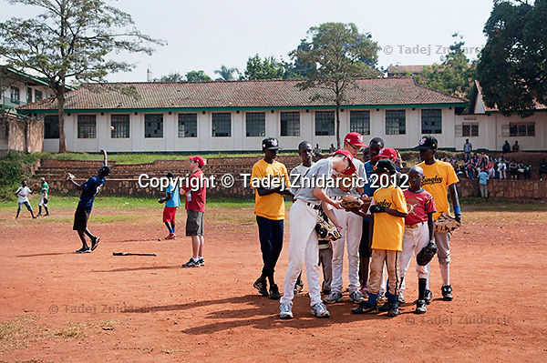 Ugandan and Canadian baseball players check the gear during practice at sports field of St. Peter's school in Nsambya, neighbourhood of Kampala, Uganda on January 16 2012. The practice, part of Pearl of Africa Series, was led by MLB shortstop Jimmy Rollins and MLB first baseman Derrek Lee and by former MLB catcher Gregg Zaun.