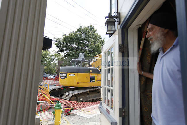 B.S. Sidhu watches the construction Tuesday afternoon at the Bombay Brazier Indian Restaurant  on the corner of South Limestone and East High.