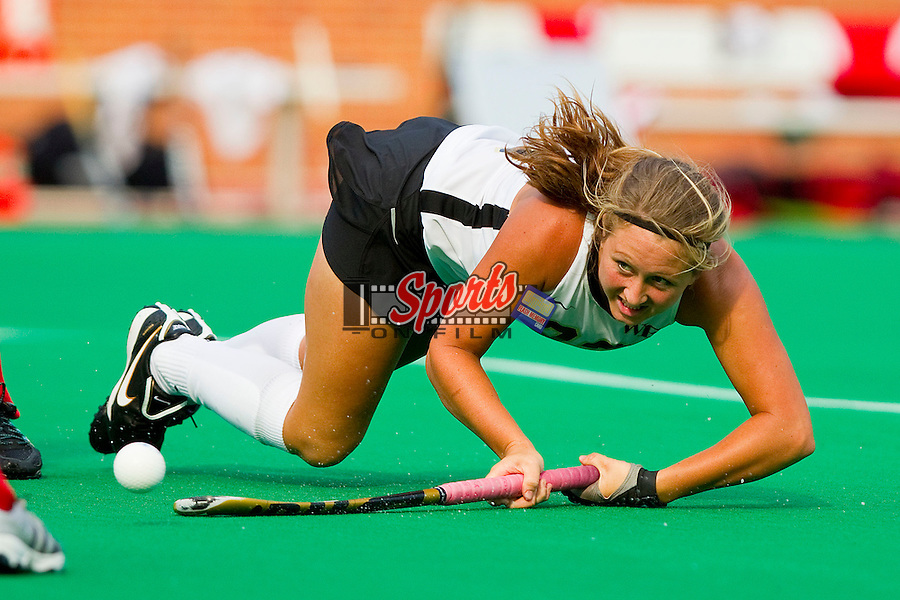 Lizzie Rae #23 of the Wake Forest Demon Deacons takes shot while falling to the ground against the Louisville Cardinals at Kentner Stadium on September 4, 2011 in Winston-Salem, North Carolina.  The Demon Deacons defeated the Cardinals 3-2 in overtime.  (Brian Westerholt / Sports On Film)