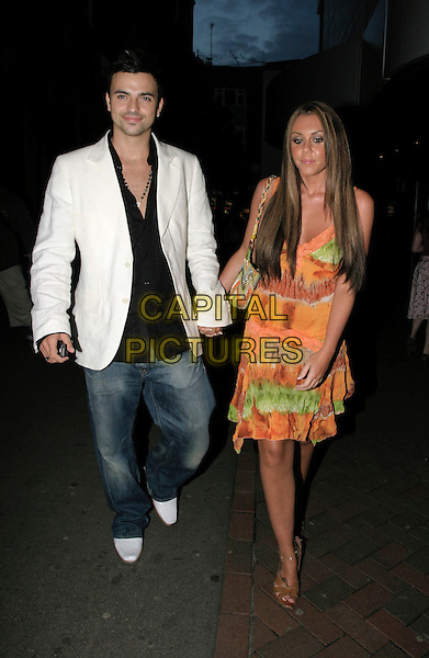 "ANDY SCOTT-LEE & MICHELLE HEATON.""Herbie Fully Loaded"" Premiere,.Leicester Square, London,.28th July 2005.full length long orange green pattern dress white jacket tainers denim jeans black shirt strappy sandals shoes.www.capitalpictures.com.sales@capitalpictures.com.© Capital Pictures."