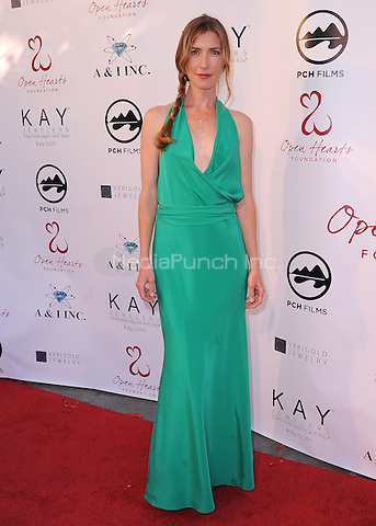 MALIBU, CA - MAY 10:  Katherine Flynn at the 4th Annual Open Hearts Gala at a private residence on May 10, 2014 in Malibu, California. Credit: PGSK/MediaPunch