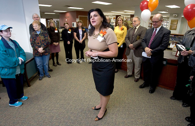 MIDDLEBURY CT. 04 November 2013-110413SV05-Jo Ann LoRusso, library director, introduced staff and welcomed everyone to the newly renovated library in Middlebury Monday. <br /> Steven Valenti Republican-American