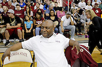 TALLAHASSEE, FLA. 10/15/10-FSUMBB 101510 CH-Florida State Men's Basketball Coach Leonard Hamilton tries to suppress a smirk after watching his team dance with the Golden Girls during the Jam with Ham basketball season kickoff Friday at Tully Gym in Tallahassee...COLIN HACKLEY PHOTO