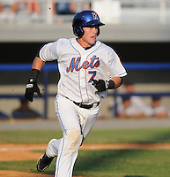Catcher Cam Maron (7) of the Kingsport Mets, Appalachian League affiliate of the New York Mets, in a game against the Burlington Royals on August 20, 2011, at Hunter Wright Stadium in Kingsport, Tennessee. Kingsport defeated Burlington, 17-14. Maron was named to the 2011 Appalachian League Postseason All-Star Team. (Tom Priddy/Four Seam Images)
