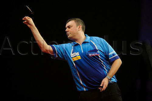 06.03.2014 Cardiff, Wales. Wes Newton in action against Dave Chisnall in a match he loses 5-7 to knock himself out of the Premier League during Judgement Night of the Betway Premier League Darts at the Motorpoint Arena.