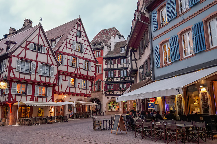 Half timbered buildings with pastel stucco highlight the center city of Colmar.