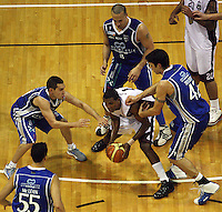 Saints players (clockwise from left) Troy McLean, Luke Martin, Brendon Polybank and Arthur Trousdell surround Heat import Mychal Green during the National Basketball League match Wellington Saints and Harbour Heat at TSB Bank Arena, Wellington, New Zealand on Saturday 13 June 2009. Photo: Dave Lintott / lintottphoto.co.nz