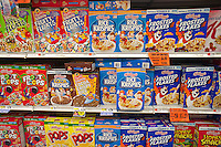 Boxes of Kellogg's breakfast cereals with generic brands mixed in on grocery store shelves in New York on Wednesday, August 22, 2012.  (© Richard B. Levine)