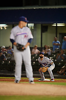 Jacksonville Jumbo Shrimp first baseman John Silviano (22) holds a runner on as relief pitcher Tyler Stevens (33) gets ready to deliver a pitch during a Southern League game against the Mobile BayBears on May 7, 2019 at Hank Aaron Stadium in Mobile, Alabama.  Mobile defeated Jacksonville 2-0.  (Mike Janes/Four Seam Images)
