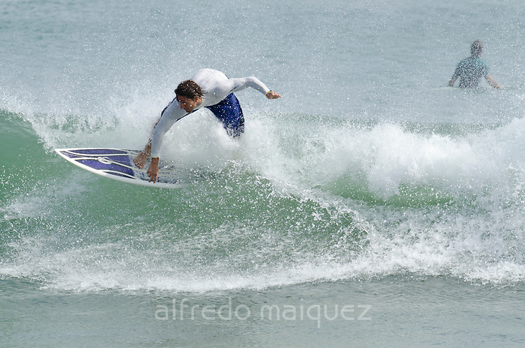 Surfer at Venao Beach. Los Santos province, Azuero peninsula, Panama, Central America.