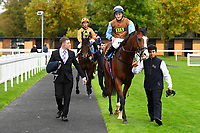 George William ridden by Tom Marquand and trained by Richard Hannon is led into the winners enclosure after winning The British Stallion Studs EBF Bathwick Tyres Conditions Stakes  during Bathwick Tyres Reduced Admission Race Day at Salisbury Racecourse on 9th October 2017