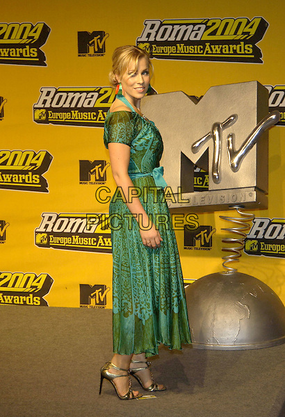 NATASHA BEDINGFIELD.MTV Europe Music Awards 2004.November 18th, 2004.full length,  green dress, printed pattern. gold shoes.www.capitalpictures.com.sales@capitalpictures.com.©Capital Pictures