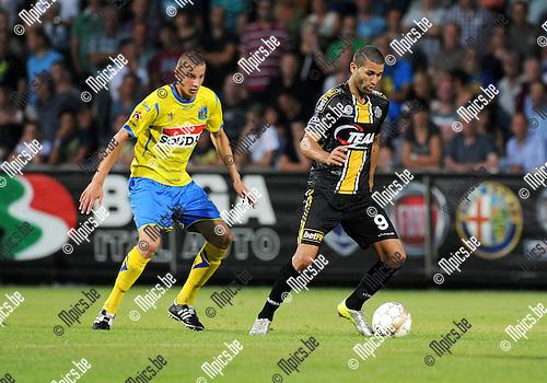 2014-07-26 / Voetbal / seizoen 2014-2015 / KVC Westerlo - Sporting Lokeren / Kenneth Schuermans (l. Westerlo) met Hamdi Harbaoui<br /><br />Foto: mpics.be
