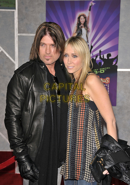 BILLY RAY CYRUS & LETICIA FINLEY.Walt Disney Pictures' World Premiere of Hannah Montana / Miley Cyrus Best of Both Worlds Concert held at El Capitan in Hollywood, California, USA..January 17th, 2008.half length black leather jacket scarf gloves red grey gray pattern circles top married husband wife .CAP/DVS.©Debbie VanStory/Capital Pictures