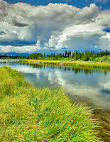 Madiosn River and building thunderstorm. Montana