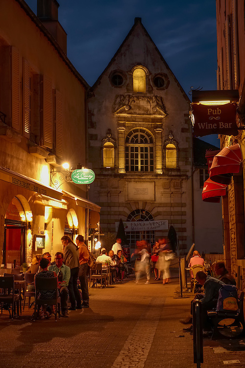 Travelers can enjoy Burgundy's classic dishes and the area's wines in outdoor cafes   along quiet cobblestone side streets.