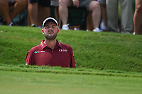 Marc Leishman (AUS) stands on his tip toes in the trap to see the pin on 1 during round 1 of the 2019 Tour Championship, East Lake Golf Course, Atlanta, Georgia, USA. 8/22/2019.<br /> Picture Ken Murray / Golffile.ie<br /> <br /> All photo usage must carry mandatory copyright credit (© Golffile | Ken Murray)