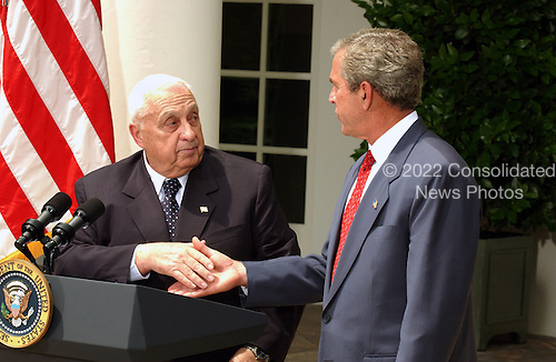 Prime Minister Ariel Sharon of Israel and United States President George W. Bush shake hands after meeting reporters in the Rose Garden at the White House in Washington, D.C. on July 29, 2003 following their earlier talks.<br /> Credit: Ron Sachs / CNP