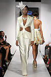 """Model walks runway in an Bridal outfit from the Jewel Shannon """"Island Pearl"""" collection, during BK Fashion Weekend Fall Winter 2012."""